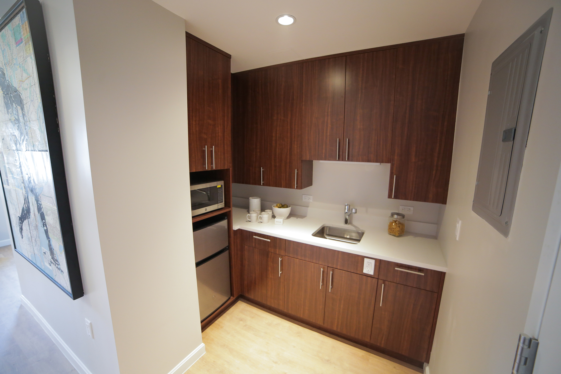 A Studio Plus kitchen featuring stainless steel appliances and large counter-tops.
